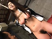 Hitomi Ohishi is tied up with a long length of rope and exposed