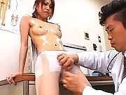 Saki Kozakura removes her uniform to show her sexy legs and tits