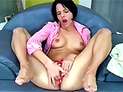 Reaching an orgasm with a big toy in her muff