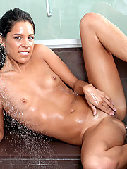 Sexy Alana G showers down her petite body and mildly hand strokes her tight juicebox