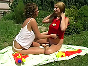 Lesbians having fun in the garden with a cock