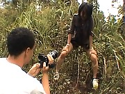 Japanese AV Model sucking cock outdoors in a wooded area