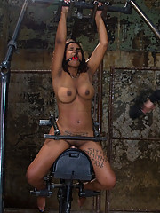 Mia Stiletto metal bound on the Sybian, caned and spanked while she cums like a whore.
