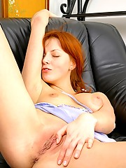 Redhead massaging her horny body for pleasure