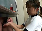 Asian chick giving two guys a horny handjob