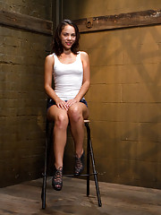 Hot little slut Kristina Rose metal bound in a kneeling back-arch, wet down and punished.
