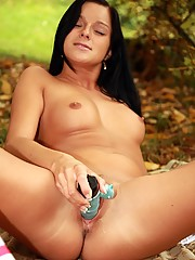 Attractive sweetie playing with clit outside