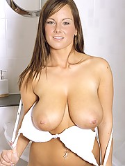 Beautiful busty brunette fondling her funbags