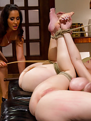 Two natural huge titted beauties are dominated, humiliated, punished, bound and strap-on fucked by Isis Love.