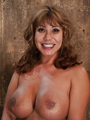 Hot MILF with huge tits, bound and made to suck cock!  Elbows together, crotch rope and a good face-fucking.  Left on floor to struggle for freedom.