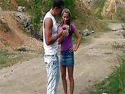 Daring teen couple having sex on a dirt road