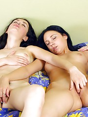 Two chicks massaging eachothers moist muffs