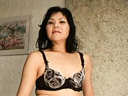 Yukiko Futaba curvy mature Asian removes her bra and panties