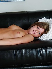 Rachel slides her naked petite body all over the leather couch