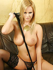 Raylene Richards posing in a gold dress and black stockings