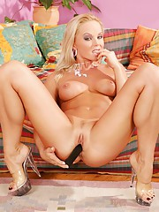 Silvia Saint stuffs a toy into her pussy