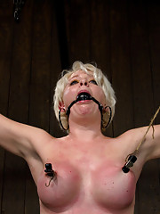Hot blond Devon Taylor and her big tits tap dance for us while chained in a most stressful standing spread.