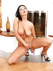 Babe with a dildo pleasures her moist clit