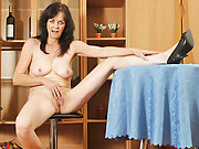 Pretty Anilos Renie strips and uses her fingers to satisfy her pussy