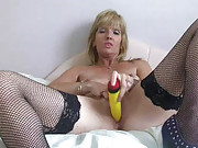 blonde babe in black stockings toys her pussy