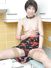 MILF hikes up her dress to flash her knickers and stockings