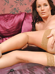 Marlyn shows off her sexy legs in tan stockings