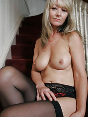 Sexy blonde MILF strips out of her stockings