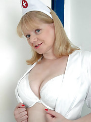 Busty MILF strips out of her nurses uniform