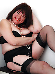 Bernadette In black stockings with metal clips