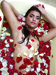 A teenage hottie taking a sexy flower bath