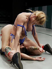 Big titted blond with killer Jiu Jitsu skills destroys porn star Tori Luxe on the mat.  Then fucks her like a common whore. Non-scripted wrestling.
