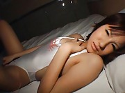 Miya Nagasaki uses a small sex toy on her nipples and pussy