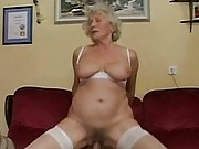 Busty old granny riding cock