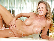Sexy tan cougar with big boobs masturbates in her bubble bath