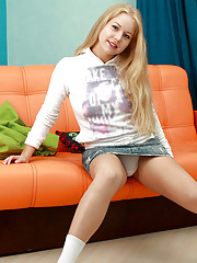 Horny babe Gaga loves to spreads her tight pussy on the sofa