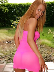 Tania wears a tight pink dress and has a little ladybug vibrator that she has some fun with