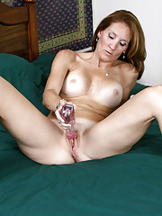 Classy Anilos milf Crystal is on her bed and banging her pussy with her rabbit toy