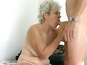 Granny enjoys sucking younger cock