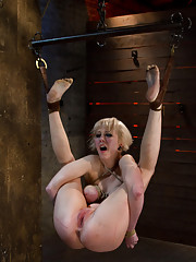 Hot blond with smoking hot body, is strung up in a unique ankle suspension.  Totally helpless, spread, caned, flogged, and made to squirt and cum!