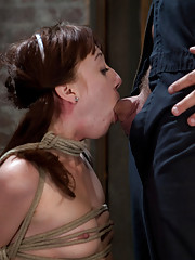 Sexy Lolita Haize, bound on her knees, held in place by her neck.  Totally helpless as cock is jammed down her throat.  Left on the floor to suffer.