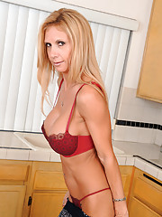 Fiesty milf Brooke Tyler gets hot and horny as she rides the monkey rocker
