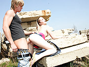Teenage beauty sucks big stiff boner outdoors