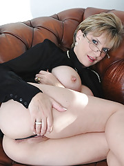 Glamorous mature stunner in glasses