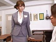 Yuma Asami sexy secretary unbuttons her blazer to show cleavage