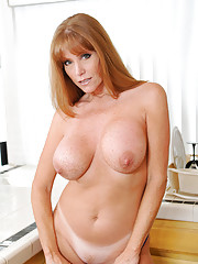 Naughty housewife shows off her big tits and sweet mature pussy in the kitchen