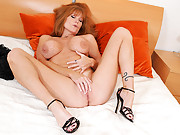 Playful red head Darla Crane exposes her big tits at Anilos