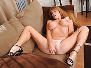 Busty red head with tan lines plays with her dildo