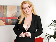 Curvy office exec undresses and fingers her shaved twat