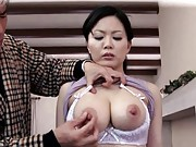 Miki Sato´s big tits are pulled out of her bra by a horny man