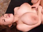 Hitomi Tanaka large boobs hang from her slim body while sucking